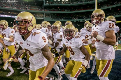 """""""Members of Boston College huddle together during the Shamrock Series Football at Fenway game against Notre Dame at Fenway Park in Boston, Massachusetts Saturday, November 21, 2015."""""""