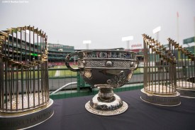 """""""The 2004, 2007, and 2013 Boston Red Sox World Series trophies and the Sam Maguire Cup are displayed during the AIG Hurling and Irish Festival at Fenway Park in Boston, Massachusetts Saturday, November 22, 2015."""""""