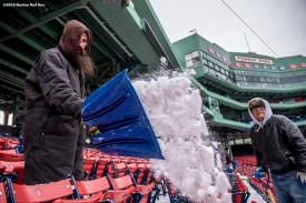 """""""A worker shovels snow from seats as progress begins on construction of the Big Air ski and snowboard ramp at Fenway Park in Boston, Massachusetts Tuesday, January 19, 2016."""""""
