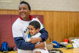 """""""Former Boston Red Sox pitcher Pedro Martinez hugs a participant during a clinic Dexter High School in Brookline, Massachusetts Monday, February 2, 2016. """""""