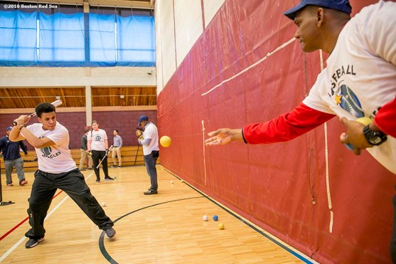 """""""A participant takes batting practice during a clinic Dexter High School in Brookline, Massachusetts Monday, February 2, 2016. """""""