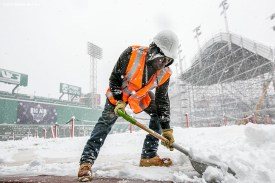 """""""A worker shovels snow as construction continues on the Polartec Big Air ski and snowboard ramp as snow falls at Fenway Park in Boston, Massachusetts Friday, February 5, 2016. """""""