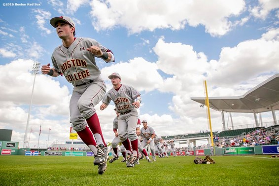 February 29, 2016, Fort Myers, FL: Members of the Boston College baseball team warm up before an exhibition game against the Boston Red Sox at JetBlue Park in Fort Myers, Florida Monday, February 29, 2016. (Photos by Billie Weiss/Boston Red Sox)