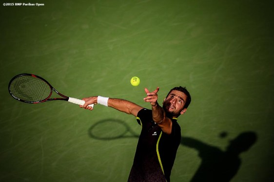"""""""Marin Cilic serves during a match against Leonardo Mayer during the 2016 BNP Paribas Open at the Indian Wells Tennis Garden in Indian Wells, California Monday, March 14, 2016."""""""
