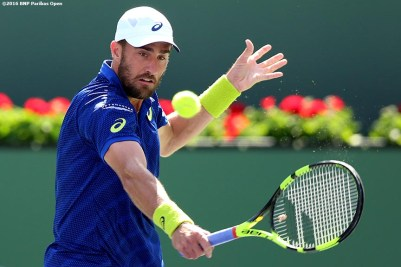 """""""Steve Johnson in action against Kei Nishikori during the 2016 BNP Paribas Open at the Indian Wells Tennis Garden in Indian Wells, California Tuesday, March 15, 2016."""""""