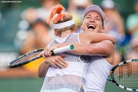 """""""Bethanie Mattek-Sands and Coco Vandeweghe react after defeating Julia Goerges and Karolina Pliskova in the women's doubles final during the 2016 BNP Paribas Open at the Indian Wells Tennis Garden in Indian Wells, California Saturday, March 19, 2016."""""""