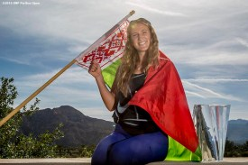 """""""Victoria Azarenka poses for a photograph with the trophy and flag of Belarus after defeating Serena Williams in the women's finals match during the 2016 BNP Paribas Open at the Indian Wells Tennis Garden in Indian Wells, California Sunday, March 20, 2016."""""""