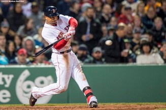 BOSTON, MA - APRIL 20: Mookie Betts #50 of the Boston Red Sox hits a two run home run during the second inning of a game against the Tampa Bay Rays on April 20, 2016 at Fenway Park in Boston, Massachusetts . (Photo by Billie Weiss/Boston Red Sox/Getty Images) *** Local Caption *** Mookie Betts