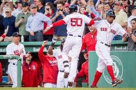BOSTON, MA - MAY 10: Mookie Betts #50 of the Boston Red Sox high fives Xander Bogaerts #2 after hitting a solo home run during the first inning of a game against the Oakland Athletics on May 10, 2016 at Fenway Park in Boston, Massachusetts. (Photo by Billie Weiss/Boston Red Sox/Getty Images) *** Local Caption *** Mookie Betts; Xander Bogaerts