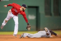 BOSTON, MA - MAY 20: Dustin Pedroia #15 of the Boston Red Sox attempts to apply a tag as Lonnie Chisenhall #8 of the Cleveland Indians steals second base during the eighth inning of a game on May 20, 2016 at Fenway Park in Boston, Massachusetts. (Photo by Billie Weiss/Boston Red Sox/Getty Images) *** Local Caption *** Dustin Pedroia; Lonnie Chisenhall