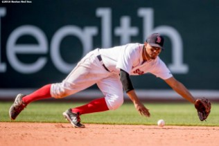 BOSTON, MA - JULY 3: Xander Bogaerts #2 of the Boston Red Sox dives as he fields a ground ball during the sixth inning of a game against the Los Angeles Angels of Anaheim on July 3, 2016 at Fenway Park in Boston, Massachusetts. (Photo by Billie Weiss/Boston Red Sox/Getty Images) *** Local Caption *** Xander Bogaerts
