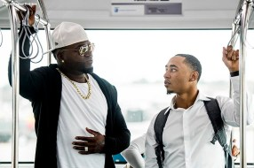 July 10, 2016, Boston, MA: Boston Red Sox designated hitter David Ortiz and right fielder Mookie Betts talk on the bus to the plane in Boston, Massachusetts Sunday, July 10, 2016 during a team charter flight to San Diego, California for the 2016 Major League Baseball All-Star Game. (Photos by Billie Weiss/Boston Red Sox)