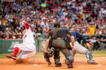 BOSTON, MA - JULY 23: Brock Holt #12 of the Boston Red Sox slides as he scores on a sacrifice fly during the first inning of a game against the Minnesota Twins on July 23, 2016 at Fenway Park in Boston, Massachusetts. (Photo by Billie Weiss/Boston Red Sox/Getty Images) *** Local Caption *** Brock Holt