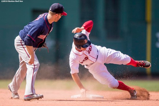 BOSTON, MA - JULY 24: Brock Holt #12 of the Boston Red Sox is tagged out by Brian Dozier #2 of the Minnesota Twins during the fifth inning of a game on July 24, 2016 at Fenway Park in Boston, Massachusetts. (Photo by Billie Weiss/Boston Red Sox/Getty Images) *** Local Caption *** Brock Holt; Brian Dozier