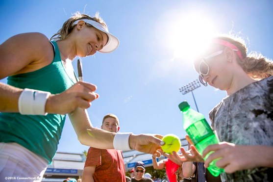 August 22, 2016, New Haven, Connecticut: Eugenie Bouchard of Canada signs autographs following a match on Day 4 of the 2016 Connecticut Open at the Yale University Tennis Center on Monday August 22, 2016 in New Haven, Connecticut. (Photo by Billie Weiss/Connecticut Open)