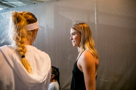 August 22, 2016, New Haven, Connecticut: Eugenie Bouchard of Canada and Caroline Wozniacki of Denmark walk through the tunnel following the Opening Ceremonies on Day 4 of the 2016 Connecticut Open at the Yale University Tennis Center on Monday August 22, 2016 in New Haven, Connecticut. (Photo by Billie Weiss/Connecticut Open)
