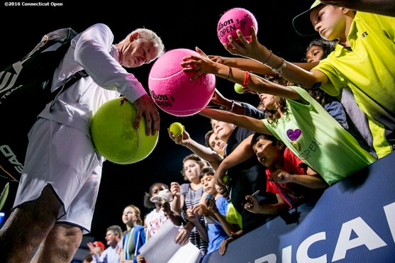 August 25, 2016, New Haven, Connecticut: John McEnroe signs autographs during the Men's Legends Event on Day 7 of the 2016 Connecticut Open at the Yale University Tennis Center on Thursday, August 25, 2016 in New Haven, Connecticut. (Photo by Billie Weiss/Connecticut Open)