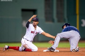 BOSTON, MA - AUGUST 30: Xander Bogaerts #2 of the Boston Red Sox tags out Logan Forsythe #11 of the Tampa Bay Rays as he attempts to steal second base during the seventh inning of a game on August 30, 2016 at Fenway Park in Boston, Massachusetts. (Photo by Billie Weiss/Boston Red Sox/Getty Images) *** Local Caption *** Xander Bogaerts; Logan Forsythe