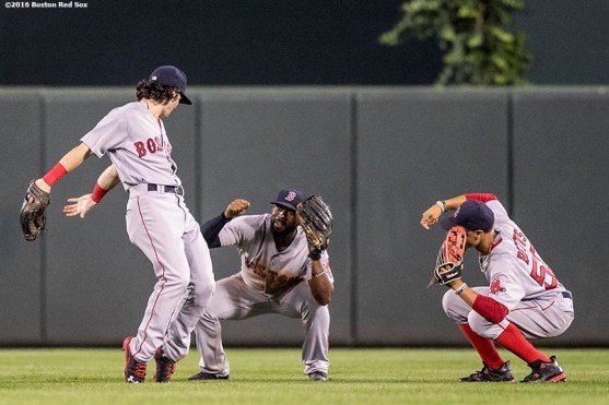 BALTIMORE, MD - SEPTEMBER 22: Andrew Benintendi #40, Jackie Bradley Jr. #25, and Mookie Betts #50 of the Boston Red Sox celebrate a victory against the Baltimore Orioles on September 22, 2016 at Oriole Park at Camden Yards in Baltimore, Maryland. (Photo by Billie Weiss/Boston Red Sox/Getty Images) *** Local Caption *** Jackie Bradley Jr.; Andrew Benintendi; Mookie Betts