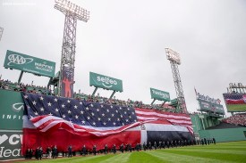 BOSTON, MA - OCTOBER 2: The American flag is dropped over the Dominican Republic flag on the Green Monster during an honorary retirement ceremony for David Ortiz #34 of the Boston Red Sox in his final regular season game at Fenway Park against the Toronto Blue Jays on October 2, 2016 at Fenway Park in Boston, Massachusetts. (Photo by Billie Weiss/Boston Red Sox/Getty Images) *** Local Caption *** David Ortiz