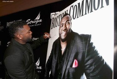 BOSTON, MA - NOVEMBER 07: David Ortiz of the Boston Red Sox autographs a Magazine Cover of himself during a Boston Common Magazine event at Strega Waterfront on November 7, 2016 in Boston, Massachusetts. (Photo by Billie Weiss/Getty Images for Boston Common Magazine)