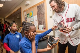 """""""Boston Red Sox pitcher Heath Hembree hands out Franklin youth baseball gloves to students at Codman Academy School as part of The Gift Of Sox and the Holiday Caravan in Dorchester, Massachusetts Thursday, December 8, 2016."""""""