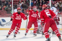 BOSTON, MA - JANUARY 08: Members of the Boston University react after scoring a goal during a Frozen Fenway game against the University of Massachusetts at Fenway Park on January 8, 2017 in Boston, Massachusetts. (Photo by Billie Weiss/Boston Red Sox/Getty Images)