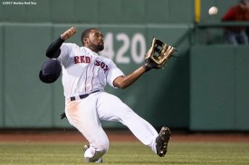BOSTON, MA - APRIL 5: Jackie Bradley Jr. #19 of the Boston Red Sox slides as he catches a line drive during the twelfth inning of a game against the Pittsburgh Pirates on April 5, 2017 at Fenway Park in Boston, Massachusetts. (Photo by Billie Weiss/Boston Red Sox/Getty Images) *** Local Caption ***Jackie Bradley Jr.