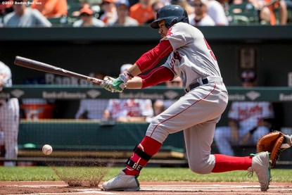 BOSTON, MA - JUNE 4: Mookie Betts #50 of the Boston Red Sox hits a single during the first inning of a game against the Baltimore Orioles on June 4, 2017 at Oriole Park at Camden Yards in Baltimore, Maryland. It was the 500th hit of his career. (Photo by Billie Weiss/Boston Red Sox/Getty Images) *** Local Caption *** Mookie Betts
