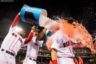 BOSTON, MA - JUNE 13: Andrew Benintendi #16 of the Boston Red Sox is doused with Powerade by Mookie Betts #50 and Deven Marrero #17 after hitting a walk-off double to end a game against the Philadelphia Phillies on June 13, 2017 at Fenway Park in Boston, Massachusetts. (Photo by Billie Weiss/Boston Red Sox/Getty Images) *** Local Caption *** Andrew Benintendi; Mookie Betts; Deven Marrero;
