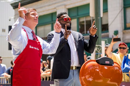 June 22, 2017, Boston, MA: Former Boston Red Sox designated hitter David Ortiz and Boston Mayor Martin J. Walsh point to the sky as they perform a skit at the grill during the unveiling of David Ortiz Drive, formerly known as Yawkey Way Extension, at Fenway Park in Boston, Massachusetts Thursday, June 22, 2017. (Photo by Billie Weiss/Boston Red Sox)