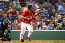 BOSTON, MA - AUGUST 18: Rafael Devers #11 of the Boston Red Sox hits a single during the eighth inning of a game against the New York Yankees on August 18, 2017 at Fenway Park in Boston, Massachusetts. (Photo by Billie Weiss/Boston Red Sox/Getty Images) *** Local Caption *** Rafael Devers