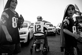 A fan looks on as he tailgates in the parking lot during the opening game of the 2017 NFL season between the New England Patriots and Kansas City Chiefs at Gillette Stadium in Foxborough, Mass. on Sept. 7, 2017. (Photo by Billie Weiss/The Players' Tribune)
