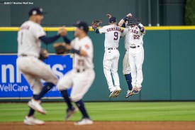 HOUSTON, TX - OCTOBER 5: Marwin Gonzalez #9, George Springer #4, and Josh Reddick #22 of the Houston Astros celebrate after recording the final out of game one of the American League Division Series against the Boston Red Sox on October 5, 2017 at Minute Maid Park in Houston, Texas. (Photo by Billie Weiss/Boston Red Sox/Getty Images) *** Local Caption *** Marwin Gonzalez; Josh Reddick; George Springer