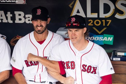 BOSTON, MA - OCTOBER 8: Rick Porcello #22 and Brock Holt #12 of the Boston Red Sox link arms before game three of the American League Division Series against the Houston Astros on October 8, 2017 at Fenway Park in Boston, Massachusetts. (Photo by Billie Weiss/Boston Red Sox/Getty Images) *** Local Caption *** Rick Porcello; Brock Holt