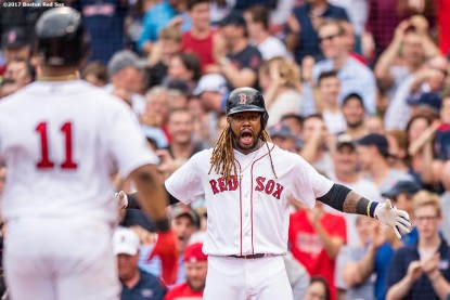 BOSTON, MA - OCTOBER 8: Rafael Devers #11 of the Boston Red Sox is congratulated by Hanley Ramirez #13 after hitting a two run home run during the third inning of game three of the American League Division Series against the Houston Astros on October 8, 2017 at Fenway Park in Boston, Massachusetts. (Photo by Billie Weiss/Boston Red Sox/Getty Images) *** Local Caption *** Rafael Devers; Hanley Ramirez