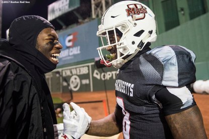 November 11, 2017, Boston, MA: A member of the University of Massachusetts reacts with teammates after scoring a touchdown during a game against the University of Maine during the Fenway Gridiron Series presented by Your Call Football at Fenway Park in Boston, Massachusetts Saturday, November 11, 2017. (Photo by Billie Weiss/Boston Red Sox)