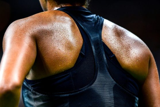 """""""Sweat drips off the back of Madison Keys during a match against Elise Mertens during the 2017 US Open Tennis Championships at the Billie Jean King National Tennis Center in New York, New York Tuesday, August 29, 2017."""""""