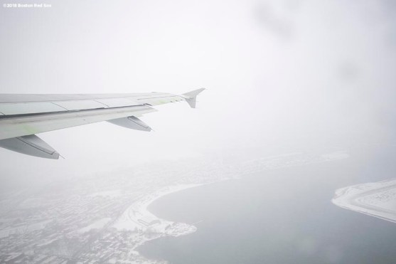 BOSTON, MA - JANUARY 30: The wing of a plane is shown as it takes off from Boston during a Boston Red Sox hurricane relief trip from Boston, Massachusetts to Caguas, Puerto Rico on January 30, 2018 . (Photo by Billie Weiss/Boston Red Sox/Getty Images) *** Local Caption ***