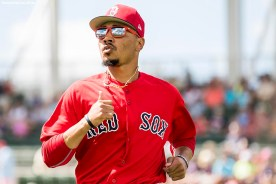FORT MYERS, FL - FEBRUARY 25: Mookie Betts #50 of the Boston Red Sox warms up during a game against the Baltimore Orioles at JetBlue Park at Fenway South on February 25, 2018 in Fort Myers, Florida. (Photo by Billie Weiss/Boston Red Sox/Getty Images) *** Local Caption *** Mookie Betts