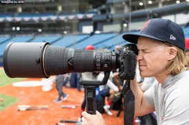 ST. PETERSBURG, FL - MARCH 28: Brock Holt #12 of the Boston Red Sox uses a camera during a team workout before Opening Day on March 28, 2018 at Tropicana Field in St. Petersburg, Florida . (Photo by Billie Weiss/Boston Red Sox/Getty Images) *** Local Caption *** Brock Holt