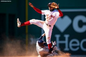 BOSTON, MA - APRIL 7: Xander Bogaerts #2 of the Boston Red Sox turns a double play over Denard Span #2 of the Tampa Bay Rays during the eighth inning of a game on April 7, 2018 at Fenway Park in Boston, Massachusetts. (Photo by Billie Weiss/Boston Red Sox/Getty Images) *** Local Caption *** Xander Bogaerts; Denard Span