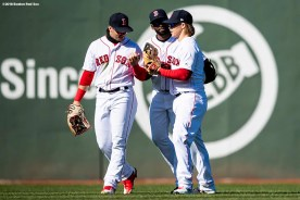 BOSTON, MA - APRIL 7: Andrew Benintendi #16, Jackie Bradley Jr. #19, and Brock Holt #12 of the Boston Red Sox celebrate a victory against the Tampa Bay Rays on April 7, 2018 at Fenway Park in Boston, Massachusetts. (Photo by Billie Weiss/Boston Red Sox/Getty Images) *** Local Caption *** Andrew Benintendi; Brock Holt; Jackie Bradley Jr.