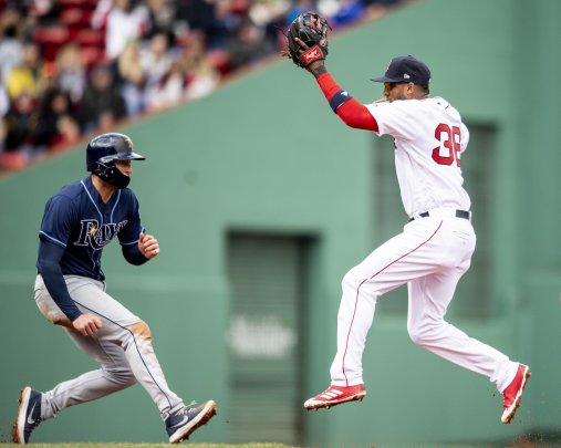 BOSTON, MA - APRIL 8: Eduardo Nunez #36 of the Boston Red Sox leaps for an overthrown ball as Brad Miller #13 of the Tampa Bay Rays evades the tag during the fourth inning of a game on April 8, 2018 at Fenway Park in Boston, Massachusetts. (Photo by Billie Weiss/Boston Red Sox/Getty Images) *** Local Caption *** Eduardo Nunez; Brad Miller