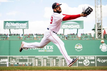 BOSTON, MA - APRIL 8: Mitch Moreland #18 of the Boston Red Sox reaches for a foul ball during the fourth inning of a game against the Tampa Bay Rays on April 8, 2018 at Fenway Park in Boston, Massachusetts. (Photo by Billie Weiss/Boston Red Sox/Getty Images) *** Local Caption *** Mitch Moreland