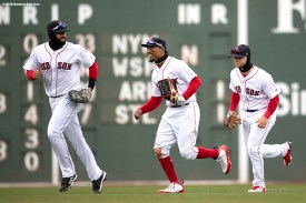 BOSTON, MA - APRIL 8: J.D. Martinez #28, Andrew Benintendi #16, and Mookie Betts #50 of the Boston Red Sox celebrate a victory against the Tampa Bay Rays on April 8, 2018 at Fenway Park in Boston, Massachusetts. (Photo by Billie Weiss/Boston Red Sox/Getty Images) *** Local Caption *** J.D. Martinez; Andrew Benintendi; Mookie Betts