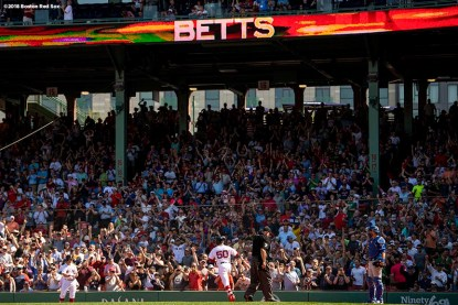 BOSTON, MA - MAY 2: Mookie Betts #50 of the Boston Red Sox crosses home plate after hitting a solo home run during the seventh inning of a game against the Kansas City Royals on May 2, 2018 at Fenway Park in Boston, Massachusetts. It was his third home run of the game. (Photo by Billie Weiss/Boston Red Sox/Getty Images) *** Local Caption *** Mookie Betts