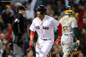 BOSTON, MA - MAY 16: Xander Bogaerts #2 of the Boston Red Sox reacts after hitting a three run home run during the sixth inning of a game against the Oakland Athletics on May 16, 2018 at Fenway Park in Boston, Massachusetts. (Photo by Billie Weiss/Boston Red Sox/Getty Images) *** Local Caption *** Xander Bogaerts