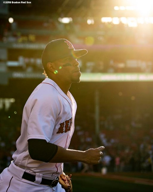 BOSTON, MA - JUNE 26: Xander Bogaerts #2 of the Boston Red Sox runs onto the field before a game against the Los Angeles Angels of Anaheim on June 26, 2018 at Fenway Park in Boston, Massachusetts. (Photo by Billie Weiss/Boston Red Sox/Getty Images) *** Local Caption *** Xander Bogaerts