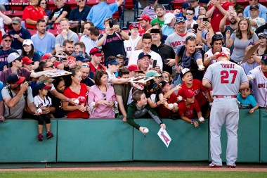 BOSTON, MA - JUNE 26: Mike Trout #27 of the Los Angeles Angels of Anaheim signs autographs before a game against the Boston Red Sox on June 26, 2018 at Fenway Park in Boston, Massachusetts. (Photo by Billie Weiss/Boston Red Sox/Getty Images) *** Local Caption *** Mike Trout